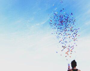 Confetti in front of blue sky